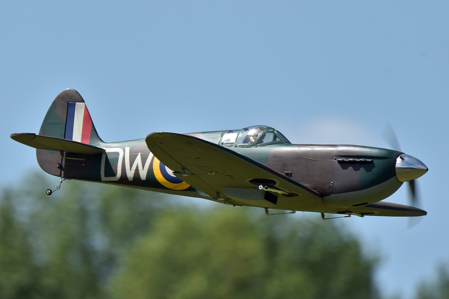 A model Spitfire passing