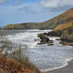 Picture of a small beach cove between steep cliffs