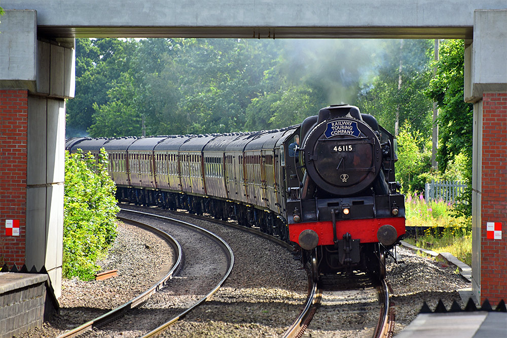 Picture of a steam locomotive passing under Aldermaston road bridge