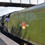 Picture of a passing steam locomotive from behind