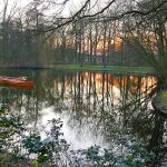 Picture of rowing boat moored in a small lake at sunset