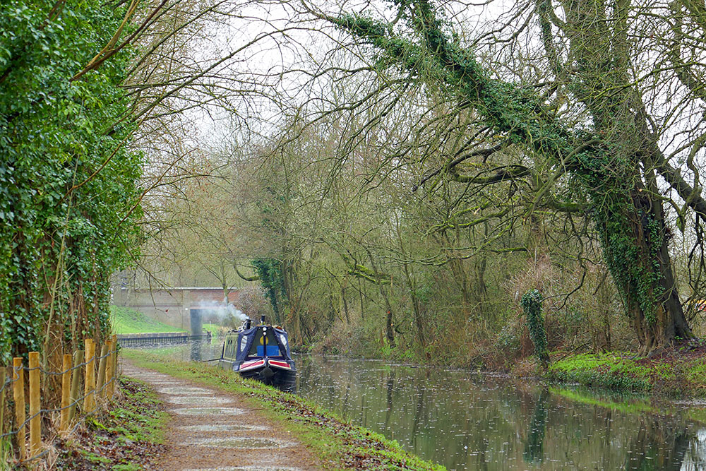 Picture of a moored canal boat with a fire going in the stove