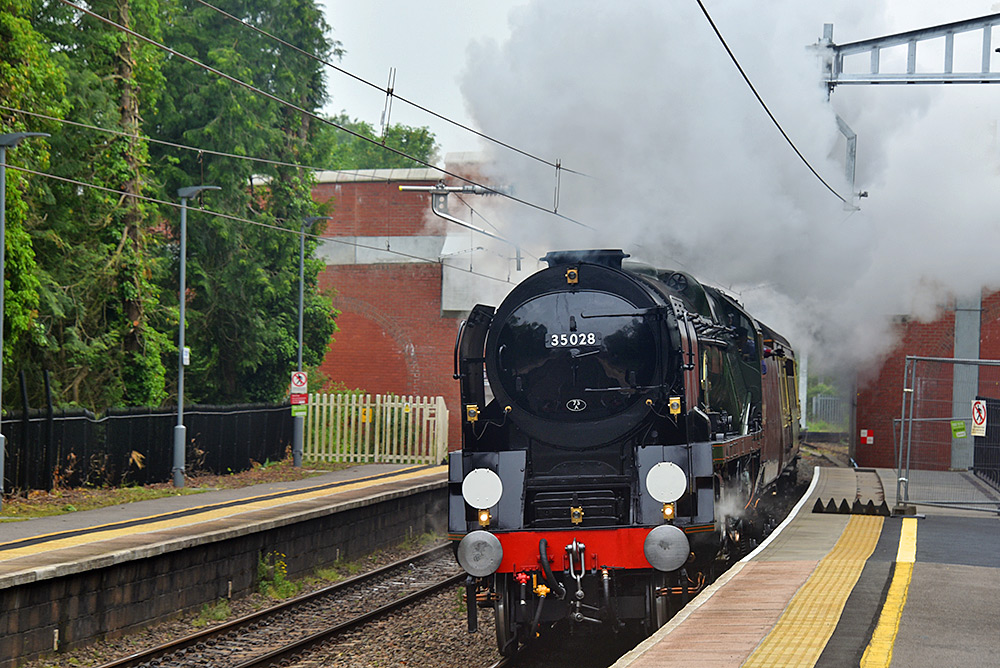 Picture of a steam train passing a station platform