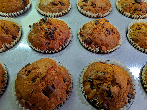 Picture of Cherry & Chocolate Chip Muffins still a in baking tray