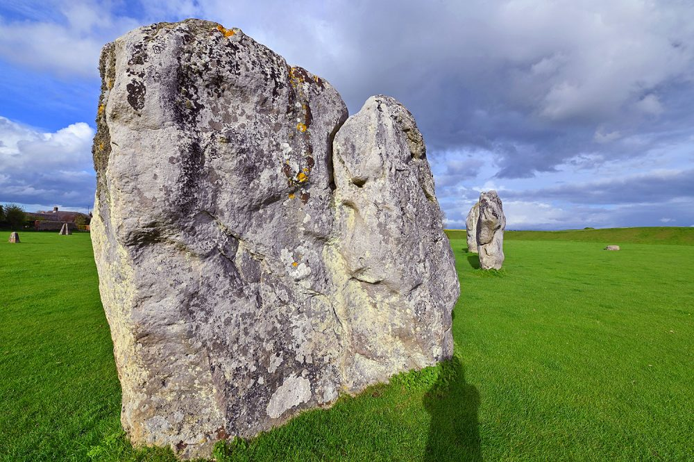 Picture of standing stones in a stone circle on a sunny May evening